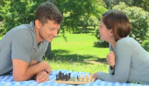 depositphotos_23501307-Young-couple-playing-chess-while-lying-on-the-grass